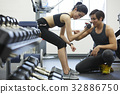 The instructor is conducting to trainee at gym center 32886750