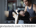 a photo of a man guiding a woman doing gymnastics. 32886804