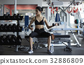 a photo of a woman doing gymnastics in a gym. 32886809