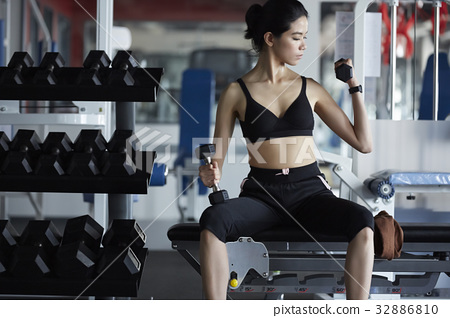 a photo of a woman working out in a gym. 32886810