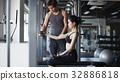a photo of a woman guiding a woman doing gymnastics. 32886818