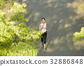 a photo of a woman running outdoors 32886848