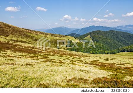 grassy hillsides on mountain ridge 32886889