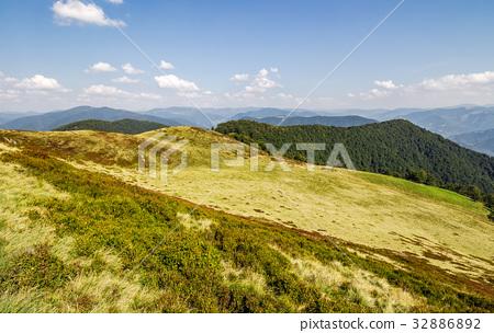 grassy hills of mountain ridge in autumn 32886892