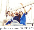 Group of happy friends traveling on a yacht 32893923