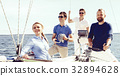 Happy friends together on a deck of a yacht 32894628