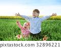 Little children boy and girl play on green grass 32896221