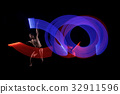 Young man ballet dancing with blue and red lights 32911596