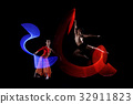 Attractive couple ballet dancer with lights 32911823