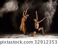 Beautiful couple ballet dancer with white powder 32912353
