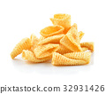 Crunchy corn snacks on a white background 32931426