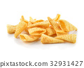 Crunchy corn snacks on a white background 32931427