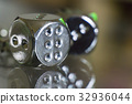 Two metal dices on glass background 32936044