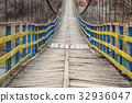 Rope suspension wooden bridge. 32936047