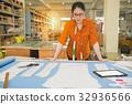 beautiful designer standing at desk look draft 32936566