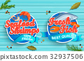 Seafood logos on blue wooden background 32937506
