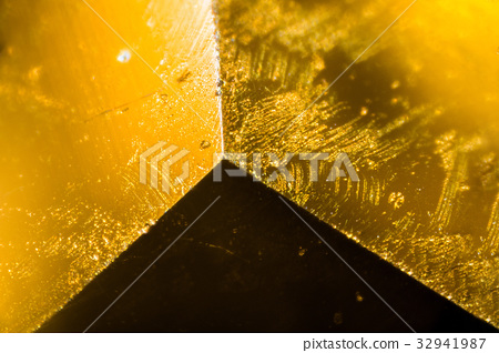 Yellow gem under the microscope 32941987