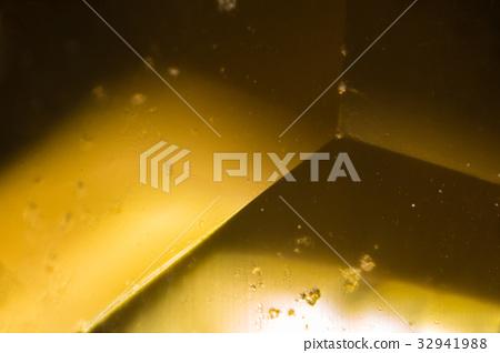Yellow gem under the microscope 32941988