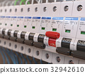 Switches in fusebox. Many black circuit brakers 32942610