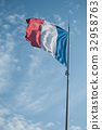 closeup of french flag on blue sky background 32958763