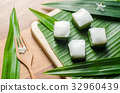 Thai jelly with coconut cream on green banana leaf 32960439
