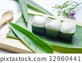 Thai jelly with coconut cream on green banana leaf 32960441
