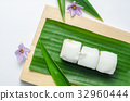 Thai jelly with coconut cream on green banana leaf 32960444