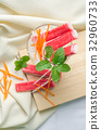 Crab stick with sliced carrot and radish in glass 32960733
