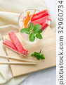 Crab stick with sliced carrot and radish in glass 32960734