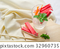 Crab stick with sliced carrot and radish in glass 32960735
