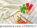 Crab stick with sliced carrot and radish in glass 32960917