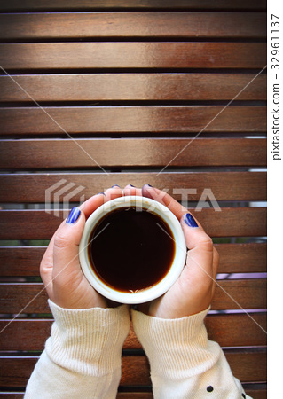 morning drink coffee with a wooden desk background 32961137