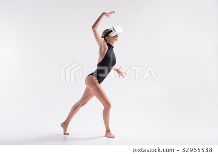 Somber youthful woman simulating dance from 32965538
