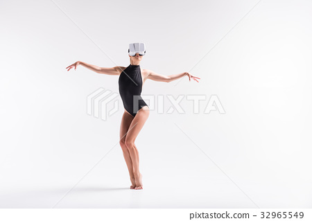 Somber youthful woman performing some dance from 32965549