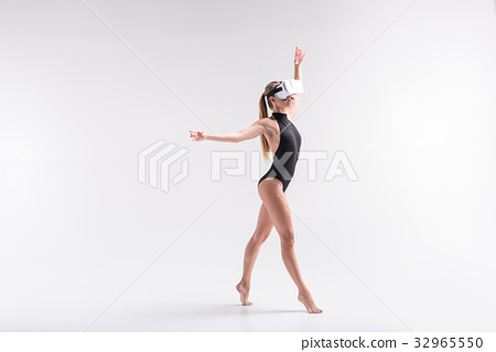 Serious youthful girl simulating sport composition 32965550