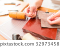 Working process of the leather wallet in the leather workshop 32973458