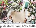Flower decorative arrangement on wooden table 32973686