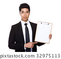 Indian businessman show with the blank page of the clipboard 32975113