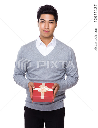 Young businessman holding with red gift box 32975127