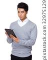 Businessman use of tablet 32975129