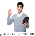 Businessman use of tablet and ok sign gesture 32975180