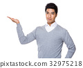 Businessman with open hand palm 32975218