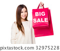 Woman hold with shopping bag showing big sale 32975228