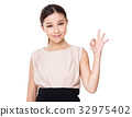 Young Businesswoman with ok sign gesture 32975402