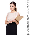 Young Businesswoman with clipboard 32975424