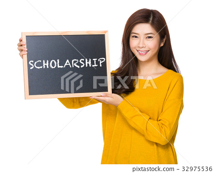 Young woman hand hold with the blackboard showing a word of scholarship 32975536