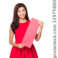 Asian woman with the blank red banner for chinese new year 32975660