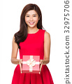 Chinese young girl hold with gift box 32975706