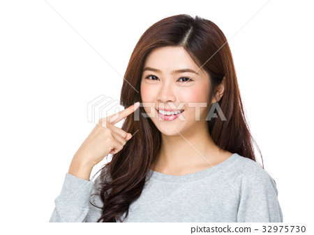 Asian Young Woman with finger point up her teeth 32975730
