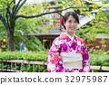 Japanese woman with kimono dressing 32975987
